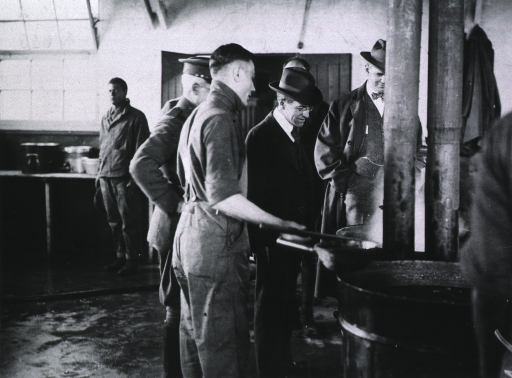 <p>Somewhere-in-England, Secretary Baker inspects an American Red Cross kitchen.</p>