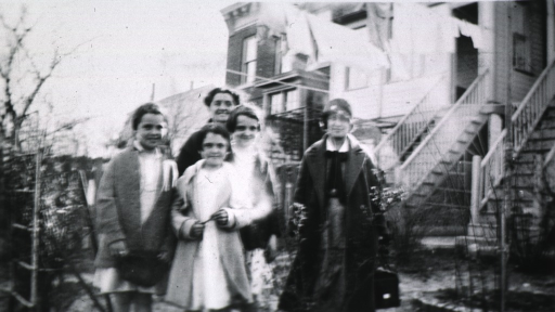 <p>Exterior view showing Miss Kramer and four members of the Thomas family.</p>