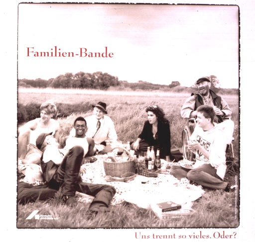 <p>White poster with a sepia-toned photograph of seven people of various age groups, ethnicities, and physically-handicapped status having a picnic in the middle of a field.  The title text is printed in crimson.  The logo of Deutsche AIDS-Hilfe appears in white on the lower left of the photograph.</p>
