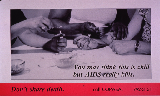 <p>Predominantly white poster with black lettering and bright pink highlights.  Visual image is a b&amp;w photo reproduction showing the hands and arms of three women who sit at a table.  One woman injects another's arm; the third woman holds a lighter to the bottom of a spoon.  Title superimposed on photo.  Caption and publisher information below photo.</p>