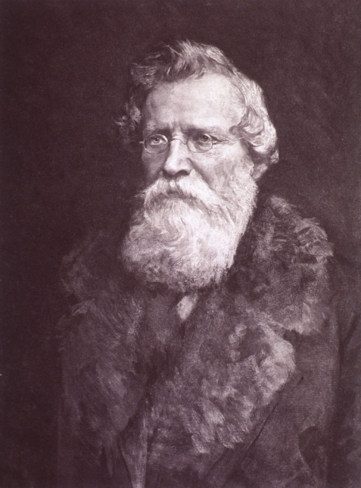 <p>Head and shoulders; front pose; wearing coat with fur collar; long beard.</p>