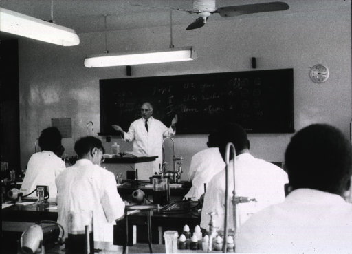 <p>Interior view of laboratory classroom: Dr. Zafari, from Iran, is lecturing to a group of microbiologists in Ibadan, Nigeria.</p>