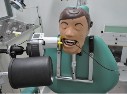 Operator's radiation dose was measured by an ionization chamber at the operator's hand level using the portable dental X-ray machine without a lead shield.