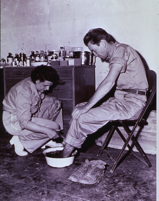 <p>Soldier getting a foot bath from an Army nurse in Korea.</p>