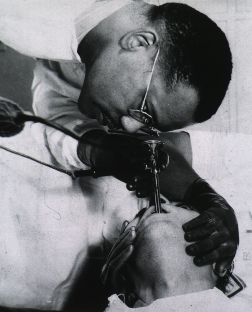 <p>Dr. Berry, an African American gastroenterologist, is using a endoscope to examine a patient.</p>