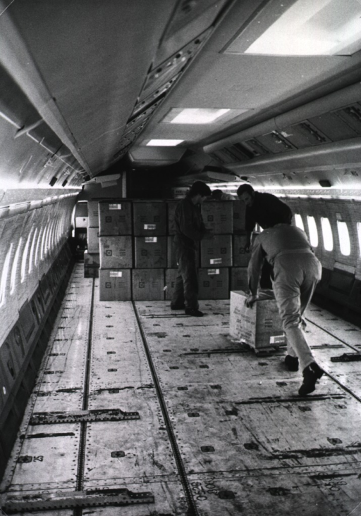 <p>Interior view of an airplane: boxes of medical supplies are being loaded for shipment to Southeast Asia.</p>
