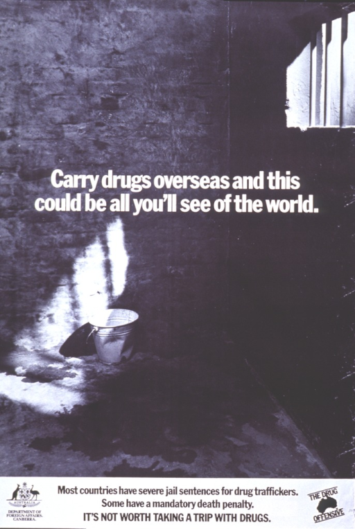 <p>Black and white poster.  Title near center of poster.  Visual image is a reproduction of a b&amp;w photo of the inside of a barren jail cell.  What little light shines into the cell highlights a bucket, suggesting the cell has no plumbing.  Caption and logos for publisher and the Drug Offensive at bottom of poster.</p>