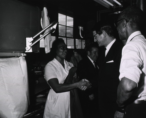 <p>Elliot Richardson meets with NIH laundry facility personnel during visit on March 16, 1971.</p>