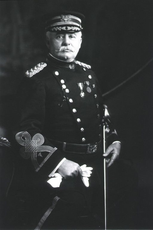 <p>Three-quarter length, standing, right pose, full face; wearing uniform and cap; holding gloves and sword.</p>