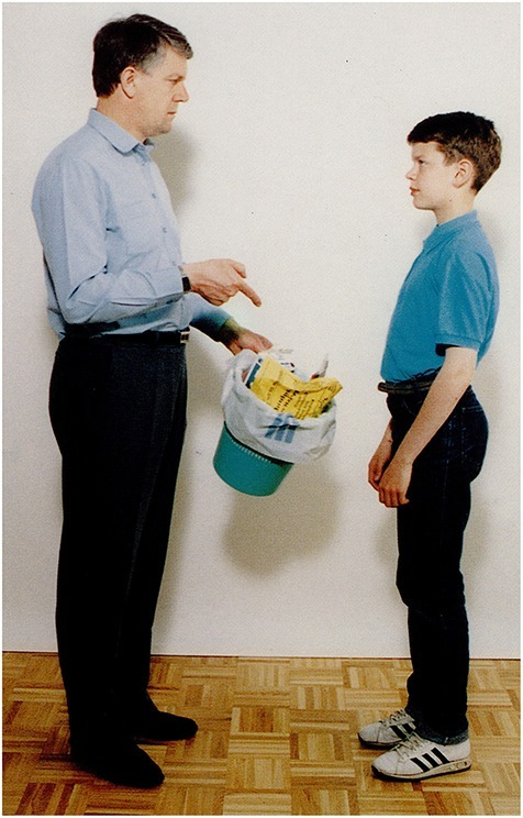 A man orders a boy to take the garbage out (Stark, 1998).