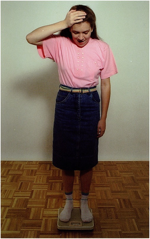 A girl is standing on bathroom scales (Stark, 1998).