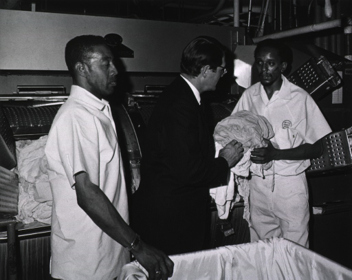 <p>Elliot Richardson observes NIH laundry operations during his visit on March 16, 1971.</p>