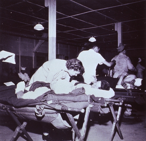 <p>United Nations nurse from Greece, with patients at Tokyo Army Hospital.</p>