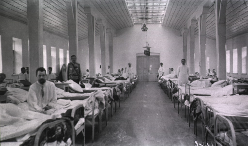 <p>Patients and medical personnel in a ward at the Kaufman No. 2 Red Cross Hospital.</p>