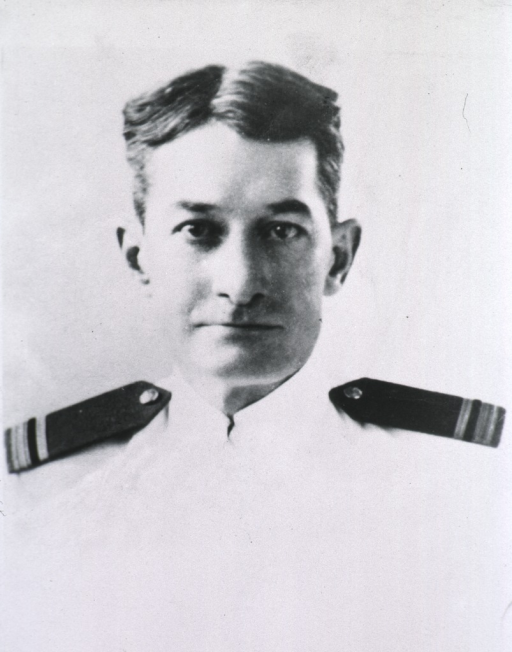 <p>Full face, wearing white uniform; hair parted in center.</p>