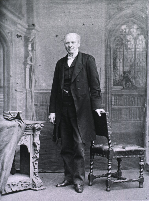 <p>Standing, left pose; hand is on the back of a chair.</p>