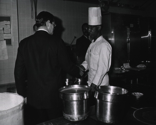 <p>Elliot Richardson meets with Coleman Chandler, Clinical Center Nurtition Dept. Chef, during his visit on March 16, 1971.</p>