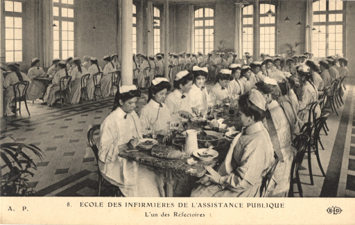 <p>Black &amp; white photograph of nursing students during meal time at the cafeteria.</p>