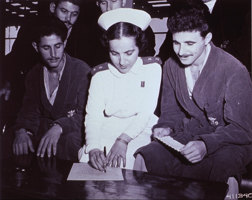 <p>United Nations nurse from Greece aids members of the Greek Expeditionary Army Forces, UNC, at Tokyo Army Hospital.</p>