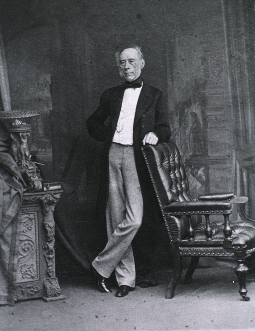 <p>Leaning against a chair, right hand behind back, left pose.</p>