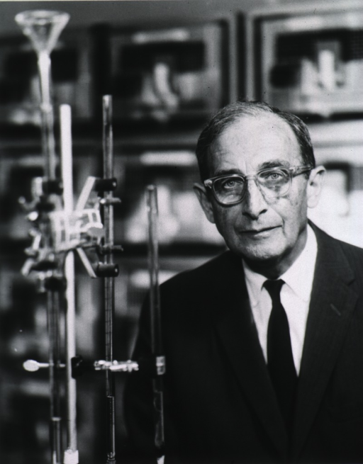 <p>Head and shoulders, full face; standing in laboratory.</p>