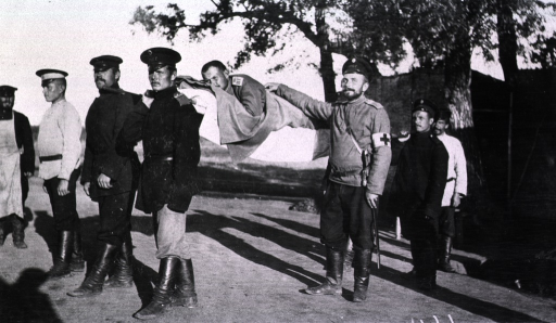 <p>A patient is carried on a litter held by four soldiers(?).</p>