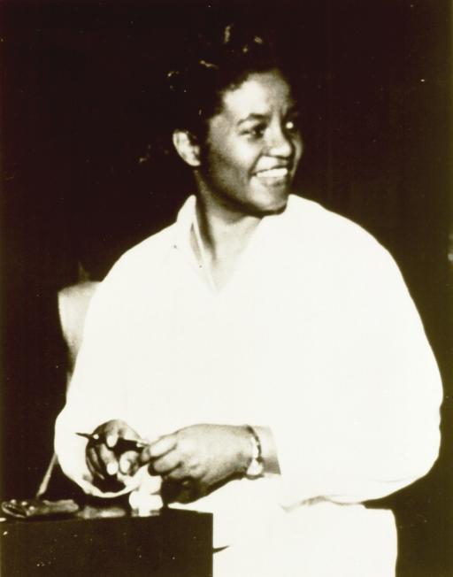 <p>Right pose, three-quarter length, standing; holding fountain pen, wearing white coat.  African American general surgeon and clinical professor of surgery.</p>