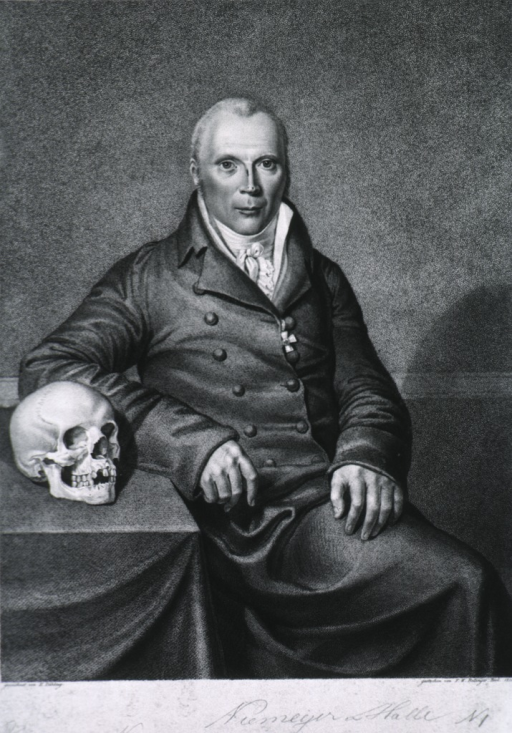 <p>Seated figure, by table, with skull, full face.</p>