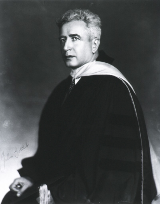 <p>Half-length, left pose; wearing academic gown.</p>