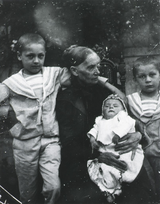 <p>Three quarter length, full face; standing with his brothers, Paul and Ladislaw, and his grandmother - taken in the Budapest studio of his grandmother.</p>