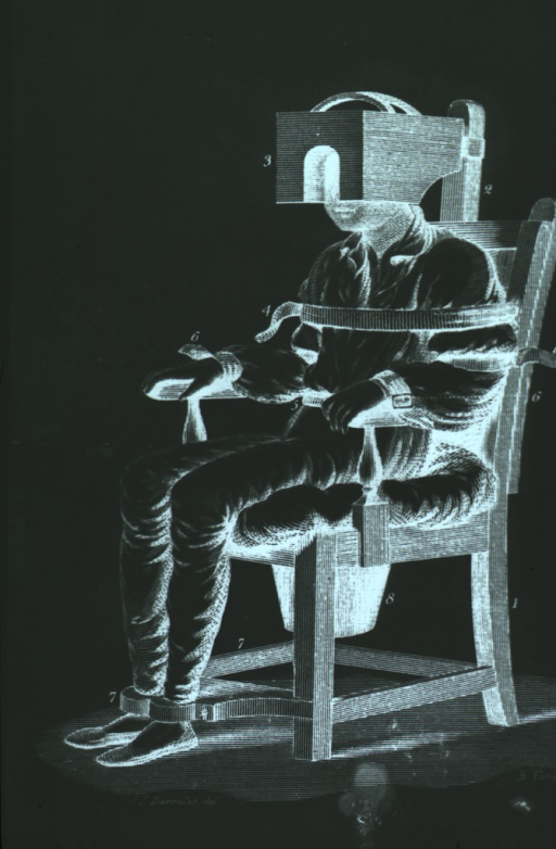 <p>A patient is sitting in a chair; his body is immobilized by straps at the shoulders, arms, waist, and feet; a box-like apparatus is used to confine the head. There is a bucket attached beneath the seat.</p>