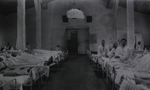 <p>Patients in a ward in a sod hospital.</p>