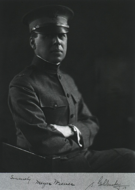 <p>Seated, half length, right pose.  Arms folded.  In uniform and cap.</p>