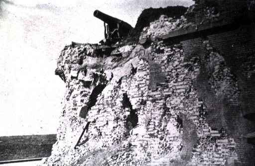 <p>A cannon rests at the top of the crumbling wall of the fort.</p>
