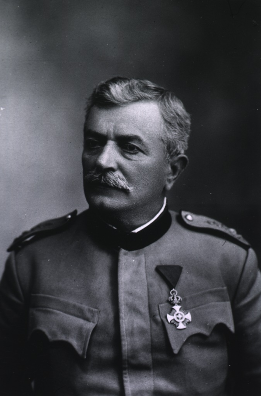 <p>Left pose, wearing uniform with medals.</p>