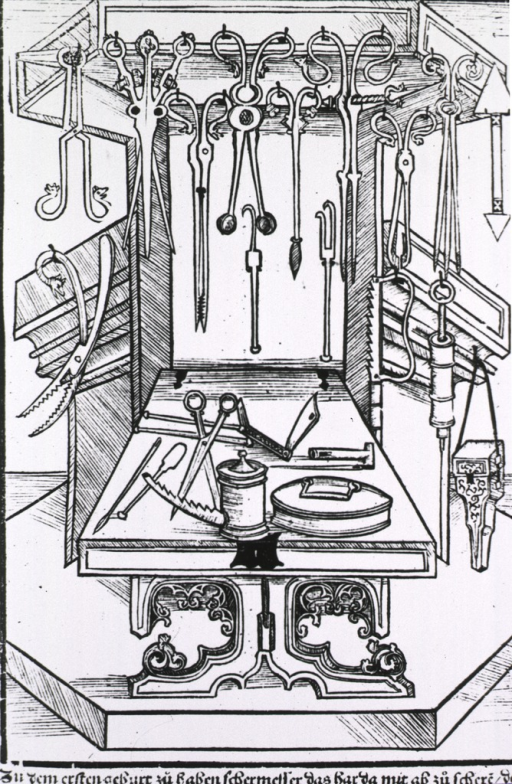<p>View of about 20 surgical instruments hung on a decorative podium-like object.</p>