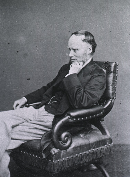 <p>Seated with chin resting on left hand; left pose.</p>