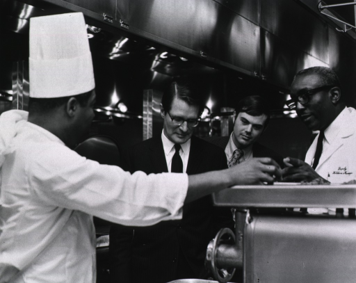 <p>Elliot Richardson meets with kitchen staff of the CC Nutrition Dept. during his visit to NIH on March 16, 1971.</p>