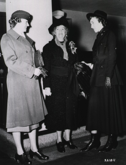 <p>Lt. Kathryne Hudson, wearing a World War I vintage Army nurse uniform, stands with Capt. Kathleen Burns and Congresswoman Edith Nourse Rogers during the 48th Anniversary of the Army Nurse Corps at Delano Hall, Walter Reed General Hospital.</p>