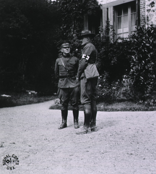 <p>Profile, out-of-doors, talking with Captain McCuster, France.</p>