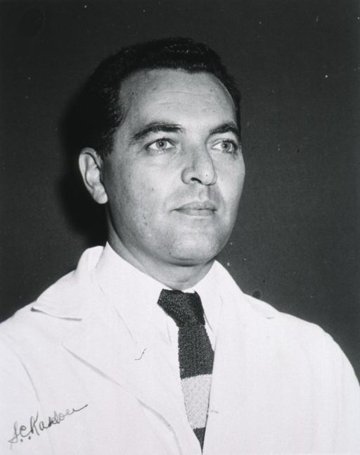 <p>Head and shoulders, right pose, full face, wearing white coat.</p>