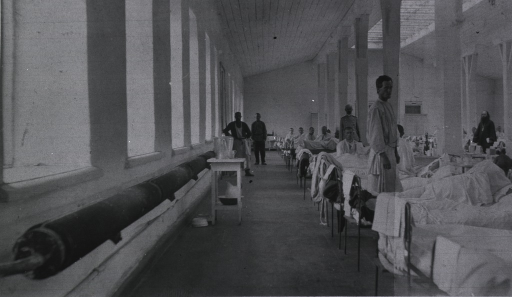 <p>Patients and medical personnel in a ward at Kaufman No. 2 Red Cross Hospital.</p>