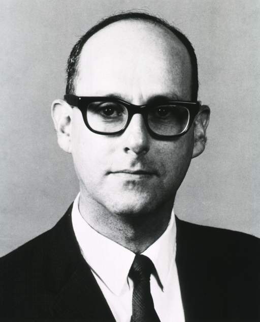 <p>Head and shoulders, full face, wearing glasses.</p>