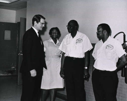 <p>Elliot Richardson meets with Mary Swader, Mr. Stanhope and Mr. Chandler of the CC's Operation Section.</p>