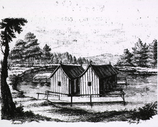 <p>Exterior view: two buildings constructed over the water of a lake.</p>