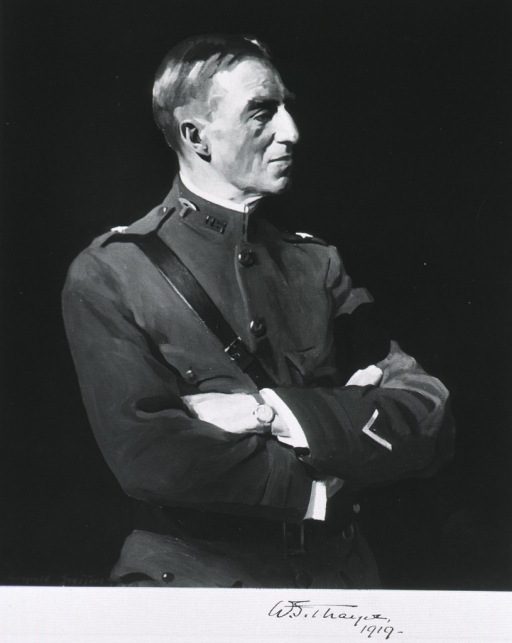 <p>Standing, half length, right pose, arms folded.  In uniform and Sam Brown belt.</p>