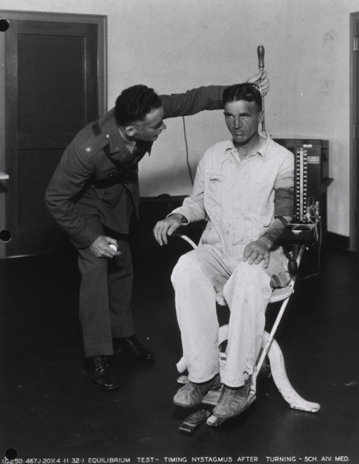 <p>Blood pressure being taken on patient after an equilibrium test using the Barany chair.</p>