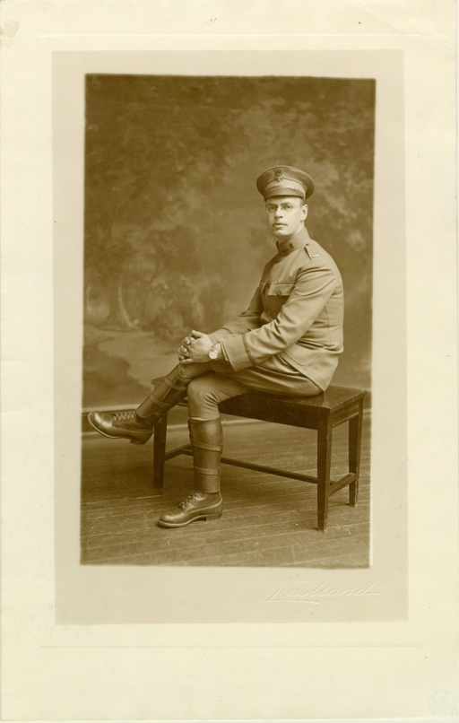 <p>Seated, left pose; hands folded on knee; in uniform.</p>