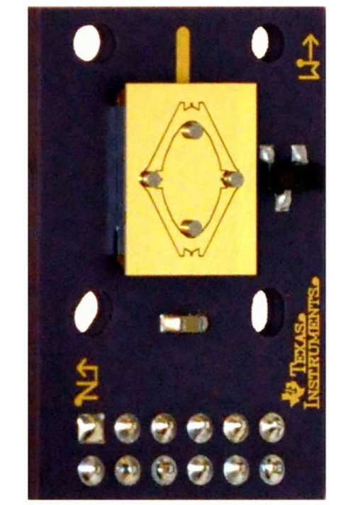 Photograph of the MEMS Analog Mirror showing two axis gimbaled mirror surface, both pairs of actuating magnets, manufacturer's directional marks, mounting holes, and 12-pin connector interface.