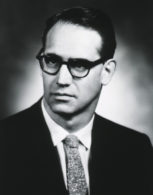 <p>Head and shoulders, turned slightly to left; wearing glasses.</p>